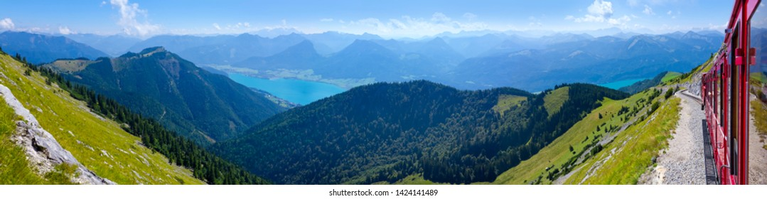 "Beautiful mountain panorama at the ""Wolfgangsee"" with the famous cog railway in Austria."