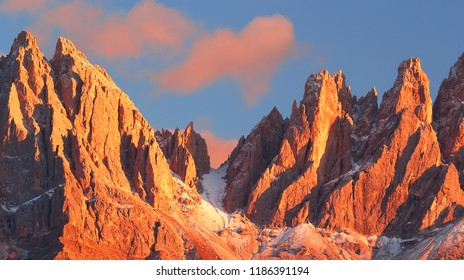 Beautiful mountain peaks covered by colored clouds at sunset, mountain landscape background