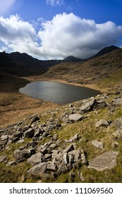 beautiful mountain range over lake in snowdonia, wales