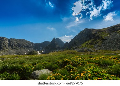 Beautiful mountain scenery with glacier lake in the Alps in summer