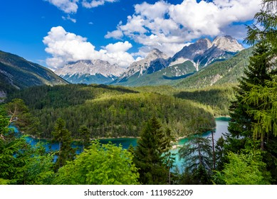 """Beautiful mountain scenery and panoramic view from the Rest Area """"Zugspitzblick"""" at the Fernpass alpine road to the Zugspitze Mountain and Lake Blindsee, Alps, Austria, Europe"""