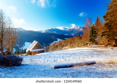 Beautiful mountain snowy landscape with cottage. Beautiful sunny day in the mountains.