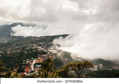 Beautiful mountain valley and city scenery of Baguio, Luzon island, Phillippines on foggy cloudy day in summer or spring time