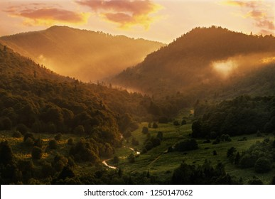 Beautiful mountain valley in summer sunlight at sunset, nature landscape background.