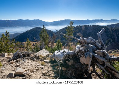 Beautiful mountain view from summit of a mountain in the Bridger-Teton National Forest near Jackson Wyoming. Fog and haze lingers in the mountain range below from a nearby wildfire