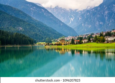 Beautiful mountain village landscape of Villapiccola and Lake Auronzo in Auronzo di Cadore, northern Italy. Nature and countryside panoramic landscape.