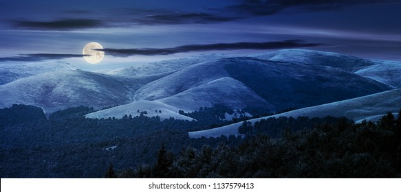 beautiful mountainous background at night in full moon light. lovely summer scene with rolling hills and gorgeous sky