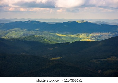 beautiful mountainous landscape background. peaceful nature scenery. clouds over the ridge and light on the forested hill