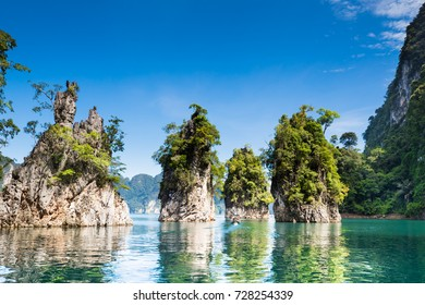 Beautiful mountains with blue sky background in Ratchaprapha Dam at Khaosok national park,surat Thani ,Thailand