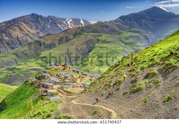Beautiful mountains and hills with goats and sheep and houses in the north of Azerbaijan near Quba in the village Khinaluq