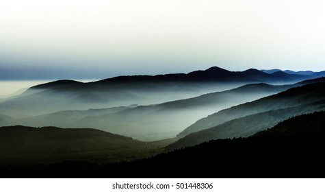 Beautiful mountains landscape from the top of the hill with fog, Alsace, France