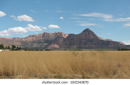 beautiful mountains panorama and dry meadow field in front of blue sky Utah USA with a beautiful view to landscape to rest after road trip