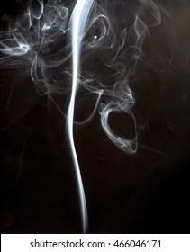 Beautiful moving moment of white smoke on black background,
