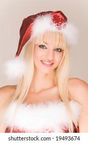 Beautiful mrs. Santa Claus in red hat
