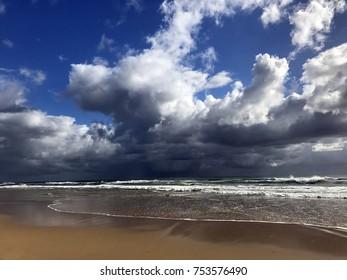 Beautiful Mudjimba beach on the Sunshine Coast Queensland, Australia with dark storm clouds looming