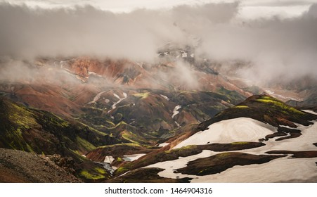 Beautiful multi coloured view of rolling hills and snow near Hrafntinnusker Iceland