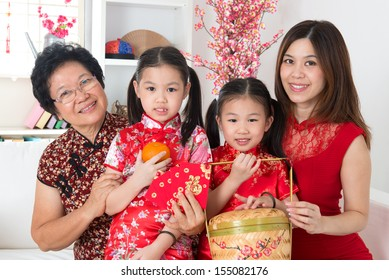 Beautiful multi generations Asian family celebrate Chinese new year at home.