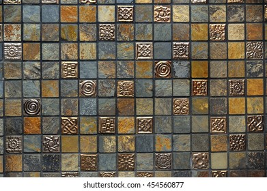 Beautiful multicolored ceramic-granite tiles with embossed metal inserts, pattern, background, texture