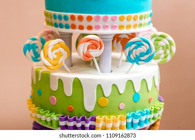 Beautiful Multi Colored Childrens Cake From Several Layers Decorated With Sweets