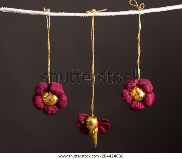 beautiful multi-colored children's soft toys on a rope isolated on a gray background