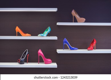 Beautiful multi-colored high-heeled shoes. Shoes on the shelf in the store.