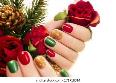 Beautiful multicolored manicure on a white background .