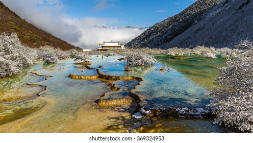 Beautiful Multi-Colored Pond (Huanglong Middle Temple on background) in the Huanglong National Park near Jiuzhaijou - SiChuan, China