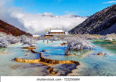 Beautiful Multi-Colored Pond (Huanglong Middle Temple on background) in the Huanglong National Park near Jiuzhaijou - SiChuan, China.