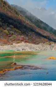 Beautiful Multi-Colored Pond in the Huanglong National Park near Jiuzhaijou after snowfall - SiChuan, China