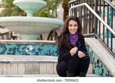Beautiful multicultural young woman posing outdoors in a shopping mall.