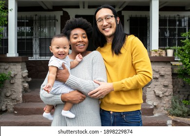 Beautiful multiethnic family standing at the porch during covid19 lockdown