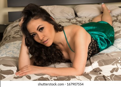 Beautiful multiracial woman in a green and black negligee