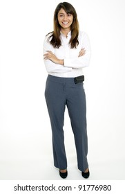 Beautiful multi-racial young woman in business attire portrait - confident. Cell phone clipped to waist with arms crossed. Full length shot against white