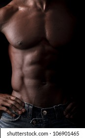 Beautiful and muscular black man in dark background