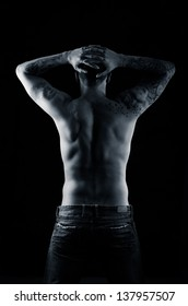 Beautiful and muscular black man's back in dark background