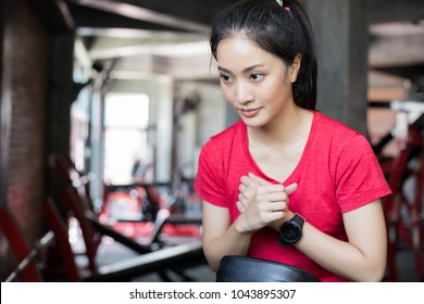 beautiful muscular fit woman exercising building muscles and fitness woman doing exercises in the gym. Fitness - concept of healthy lifestyle