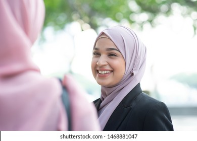 Beautiful Muslim business woman talking and smile.