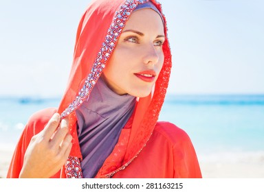 beautiful muslim caucasian (russian) woman wearing red dress rel