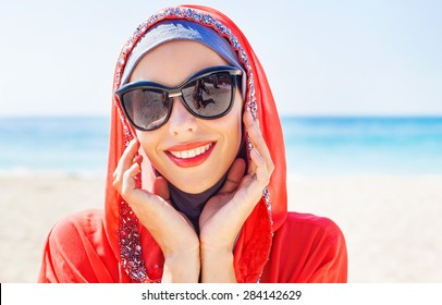beautiful muslim caucasian woman wearing sunglasses