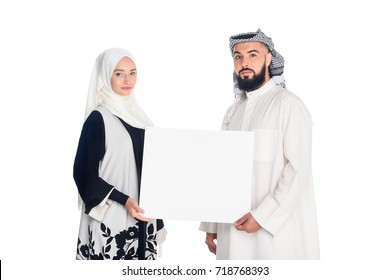 beautiful muslim couple holding blank board isolated on white