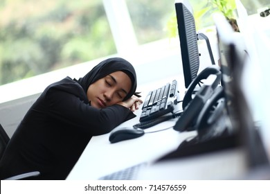 Beautiful muslim lady sleeping at her desk