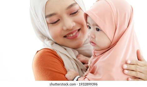 Beautiful muslim mother holding her baby.Muslim family mom and child concept domestic life.
