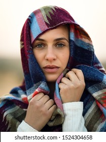 Beautiful muslim religion girl wearing hijab on her head looking dramatically with her amazing gray blue eyes