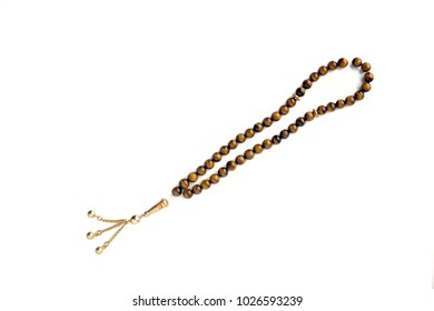 Beautiful of Muslim rosary prayer beads isolated on white background. Tiger's eye stone. Islam religion. Copy Space.