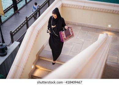 Beautiful muslim woman enjoying shopping time in the city.