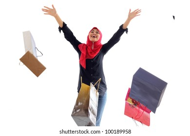 Beautiful muslim woman feel happy holding shopping bag isolated on white