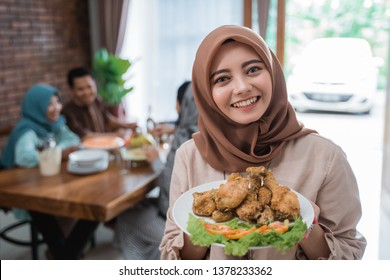 beautiful muslim woman with food served for family and friend for dinner together