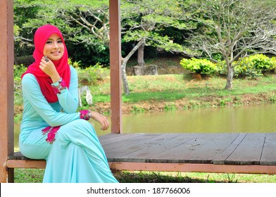 Beautiful muslimah lady wear blouse and hijab posing at garden