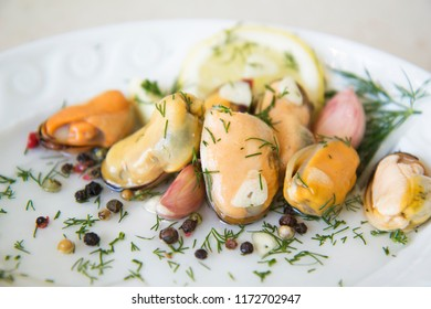 Beautiful mussels in oil, mussels in a plate, mussels in sauce and in a deep plate