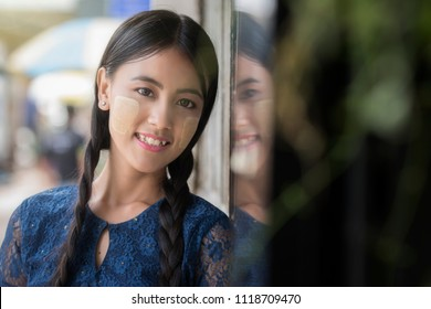 A beautiful  Myanmar woman, Yangon Myanmar,vintage style. Young Myanmar girls with Thanaka, a yellowish-white paste made from ground bark and used as a cosmetic and for sunburn protection.
